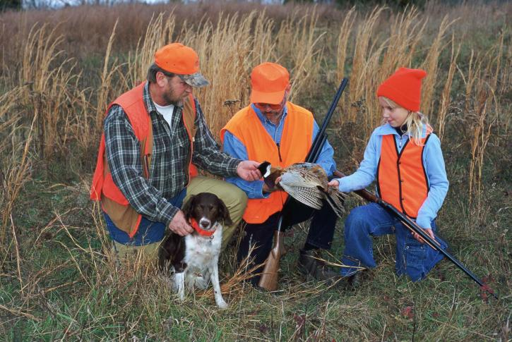 two-men-a-young-girl-and-a-dog-hunt-pheasant-together-725x485